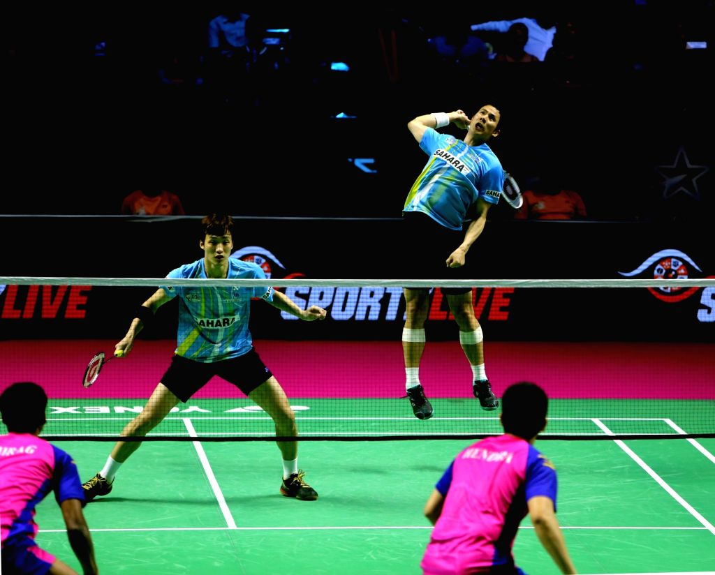 Badminton players Ko Sung Hyun and Shin Baek Cheol in action during the Premier Badminton League at the GMC Balayogi SATS Indoor Stadium in Hyderabad on Feb 3, 2020.