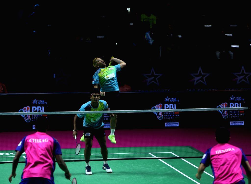 Badminton players Krishna Prasad and Bodin Isara in action during the Premier Badminton League at the GMC Balayogi SATS Indoor Stadium in Hyderabad on Feb 1, 2020.