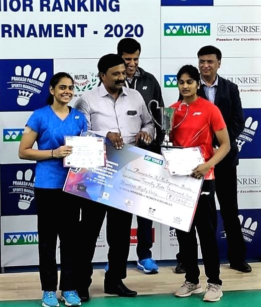 Badminton players Rutaparna Panda and Maneesha K pose with their Womens' Doubles trophy at the Yonex Sunrise All India Senior Ranking Tournament in Bengaluru on Jan 12, 2020.