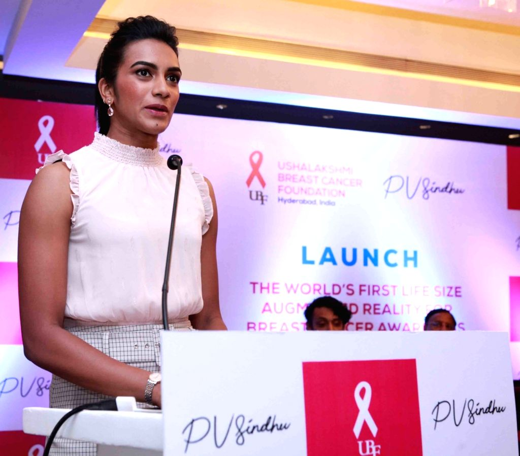 Badminton World Champion P.V. Sindhu addresses at the launch of of a first-of-its-kind campaign that uses augmented reality to raise awareness about Breast Cancer, in Hyderabad on Oct 7, ...