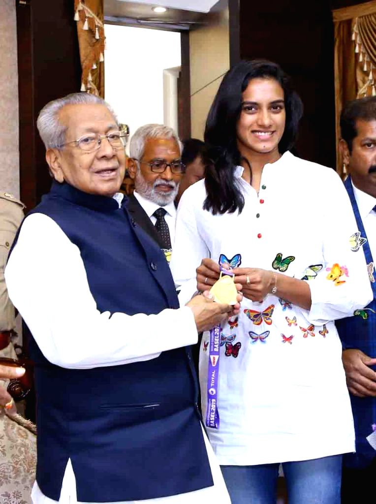 Badminton World Champion P.V. Sindhu meets Andhra Pradesh Governor Biswabhusan Harichandan at Raj Bhavan in Hyderabad on Sep 13, 2019.