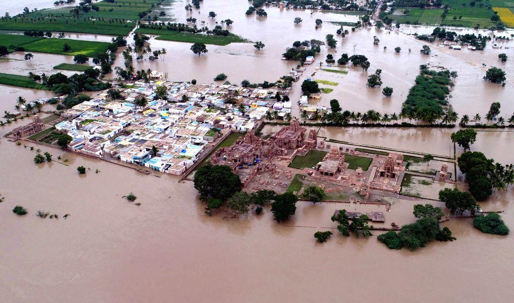 Bagalkot: An aerial view of flood hit Pattadakal at Badami Taluk, in Karnataka's Bagalkot on Aug 11, 2019. (Photo: IANS)
