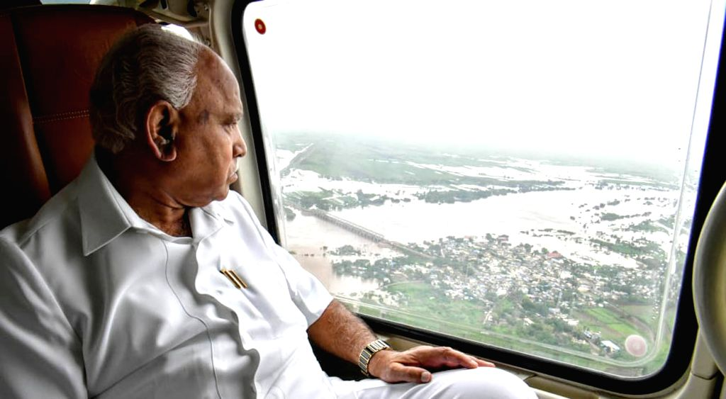 Bagalkot: Karnataka Chief Minister B.S. Yediyurappa conducts aerial survey of flood hit Bagalkot in Karnataka on Aug 9, 2019. (Photo: IANS) - B.