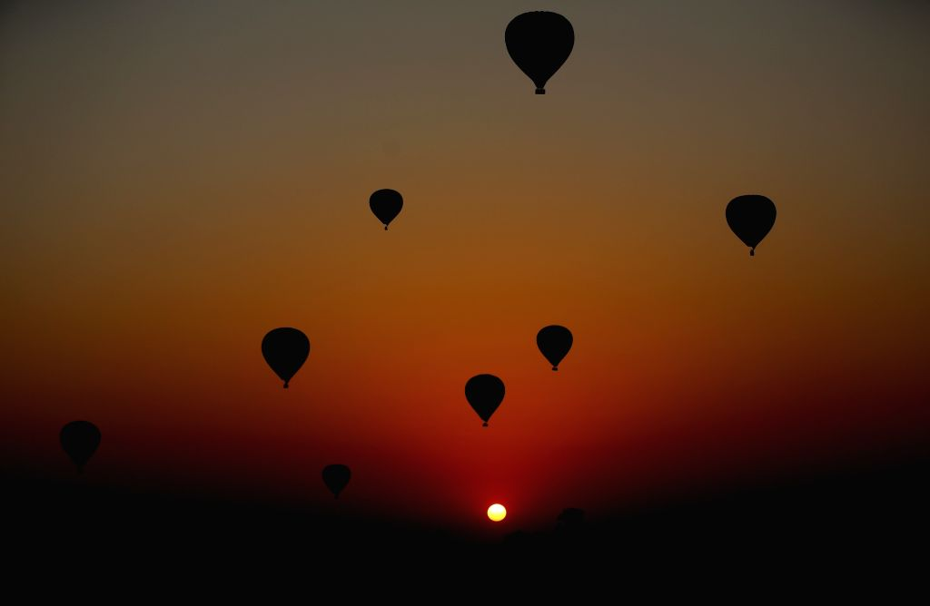 BAGAN, Feb. 21, 2019 - Photo taken on Feb. 21, 2019 shows hot air balloons flying during sunrise at the ancient city of Bagan in Mandalay region, Myanmar. Myanmar hosted a two-day workshop on ...