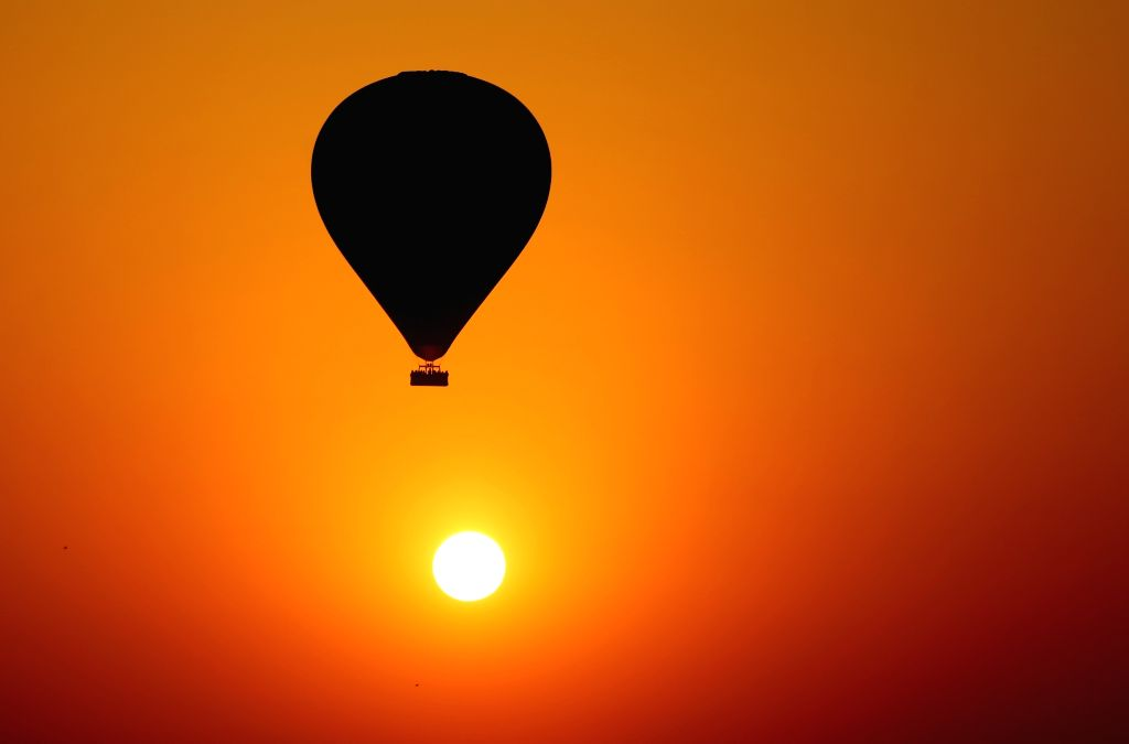 BAGAN, Feb. 21, 2019 - Photo taken on Feb. 21, 2019 shows a hot air balloon flying during sunrise at the ancient city of Bagan in Mandalay region, Myanmar. Myanmar hosted a two-day workshop on ...