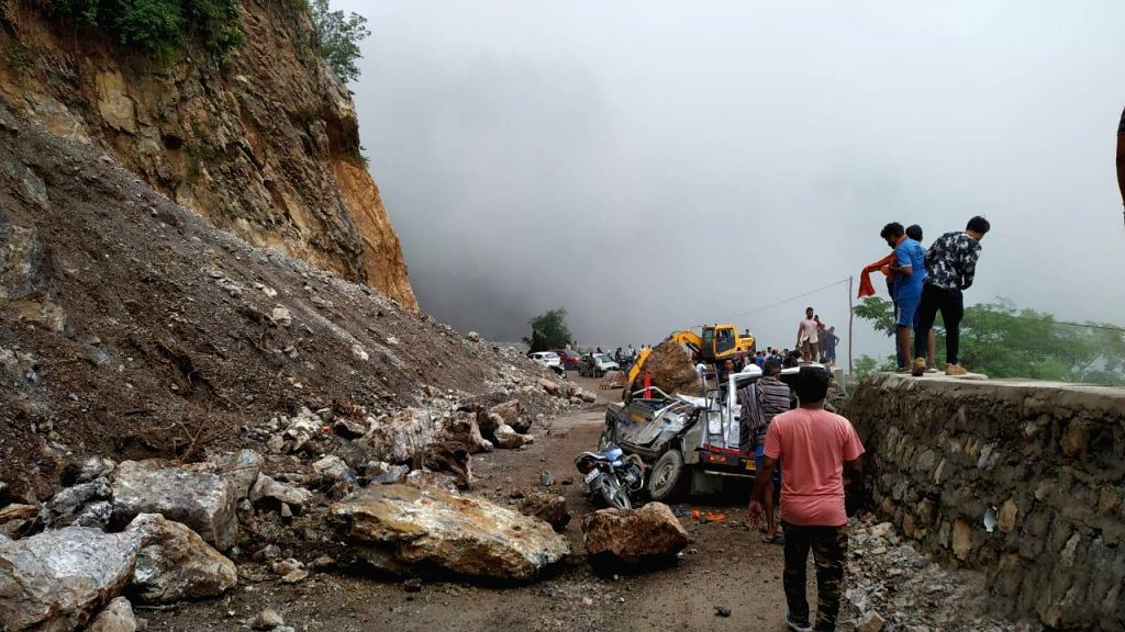 Bagardhar: Vehicles damaged in a landslide that occurred near Uttarakhand's Bagardhar, on July 28, 2019. (Photo: IANS)
