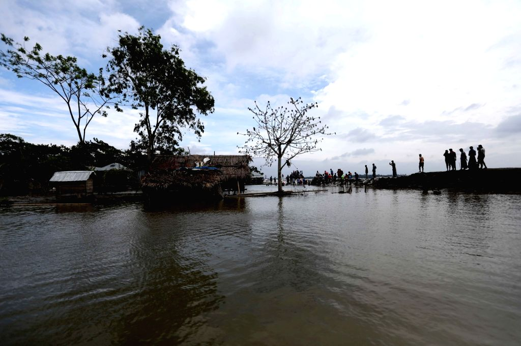 Bagerhat, May 4, 2019 - Photo taken on May 4, 2019 shows a village inundated after embankments broken in a cyclonic tidal surge in Bagerhat District, Bangladesh. At least six people were killed as ...