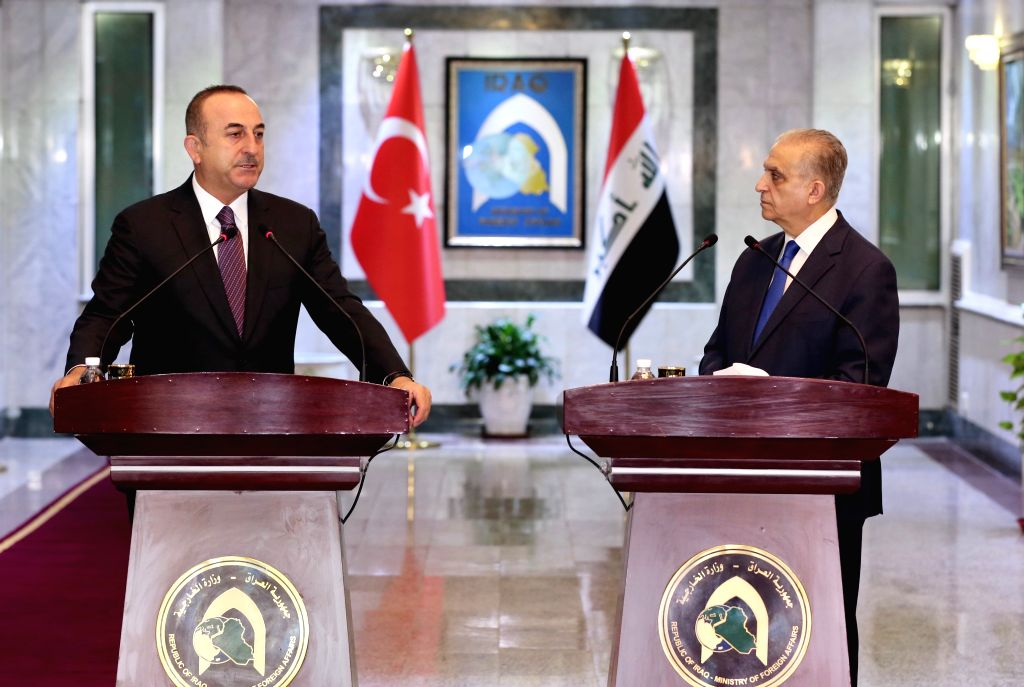 BAGHDAD, April 28, 2019 - Iraqi Foreign Minister Mohammed al-Hakim (R) and visiting Turkish Foreign Minister Mevlut Cavusoglu attend a press conference in Baghdad, Iraq, April 28, 2019. - Mohammed