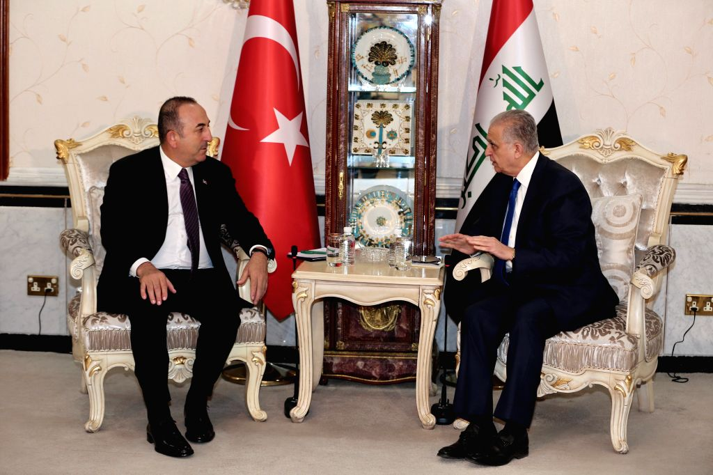 BAGHDAD, April 28, 2019 - Iraqi Foreign Minister Mohammed al-Hakim (R) meets with visiting Turkish Foreign Minister Mevlut Cavusoglu in Baghdad, Iraq, April 28, 2019. - Mohammed