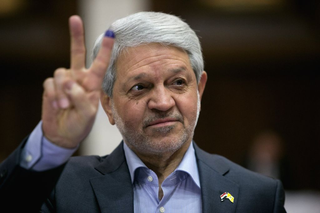 Baqir Jabr al-Zubeidi, the head of the citizen parliamentary bloc of Iraq, shows his inked finger at a polling station in the green zone in Baghdad, Iraq, April ...