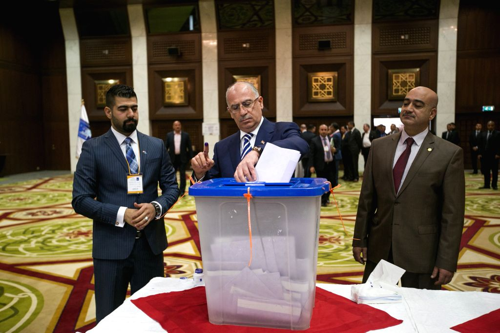 Iraqi Parliament Speaker Osama al-Nujaifi casts his vote at a polling station in the green zone in Baghdad, Iraq, April 30, 2014. Iraqis began to cast their ... - Osama