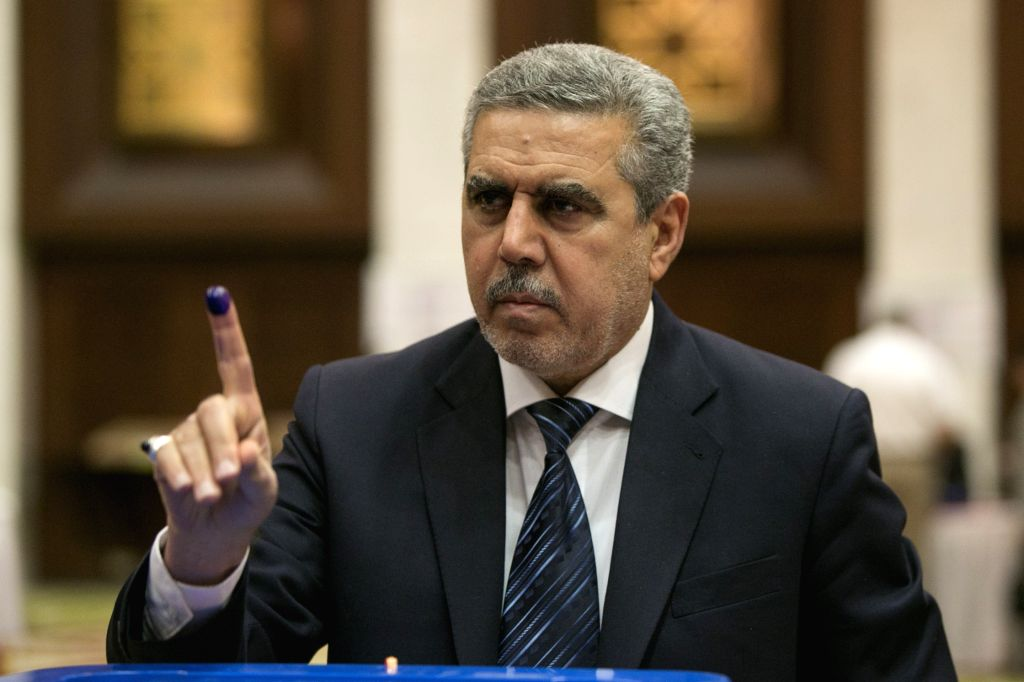 Iraqi Vice President Khodair al-Khzaie shows his inked finger at a polling station in the green zone in Baghdad, Iraq, April 30, 2014. Iraqis began to cast their ..