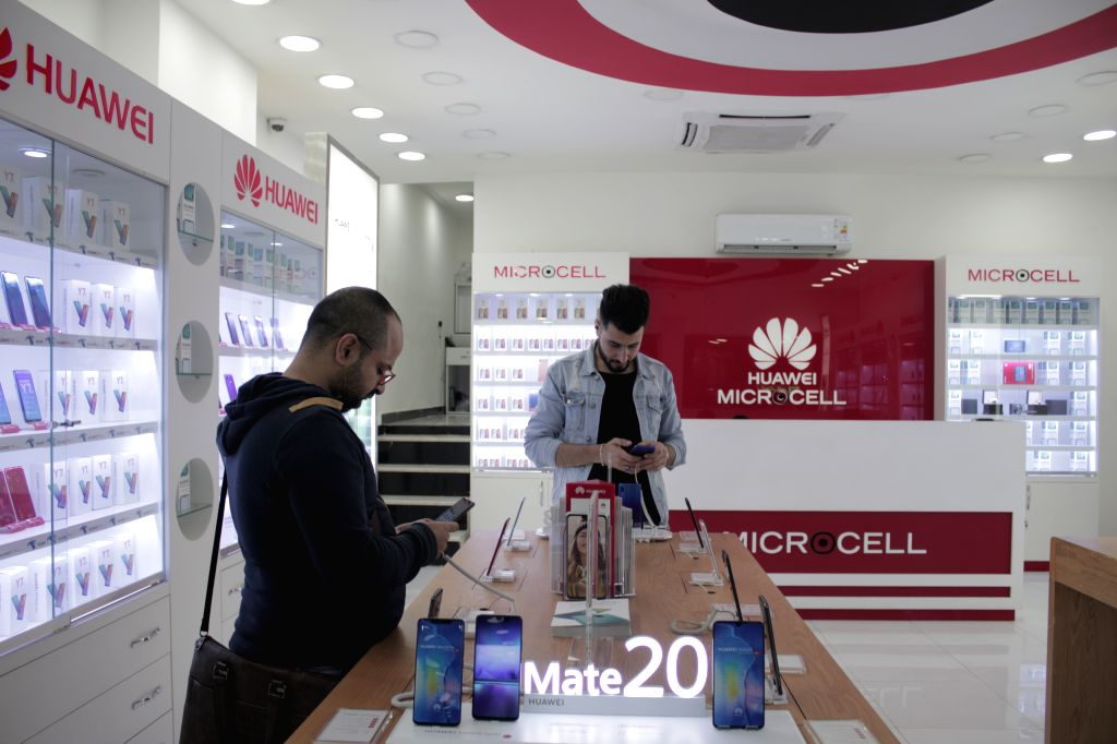 BAGHDAD, April 9, 2019 - Iraqi customers look at Chinese smart phones in Baghdad, Iraq, March 30, 2019. Over the past seven years, the Iraqi customers have gradually been attracted to the Chinese ...