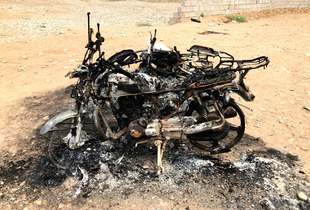 BAGHDAD, Aug. 25, 2019 - Charred remains of motorcycles are seen at the site of a mortar attack by Islamic State (IS) militants in Kirkuk province, Iraq, on Aug. 25, 2019. A total of five civilians ...
