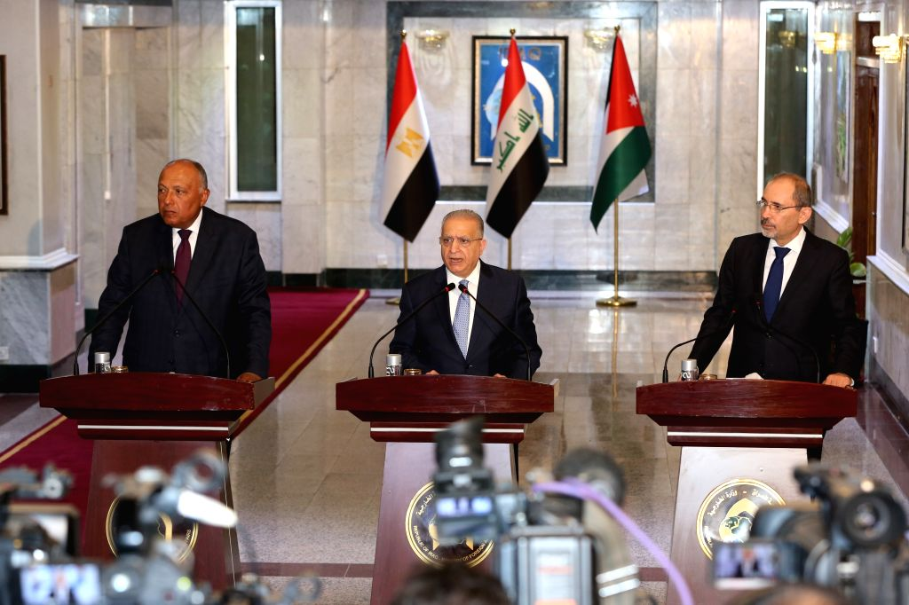 BAGHDAD, Aug. 4, 2019 - Iraqi Foreign Minister Mohammed al-Hakim (C), Jordan's Foreign Minister Ayman Safadi (R) and Egyptian Foreign Minister Sameh Shoukry attend a joint press conference in ... - Mohammed