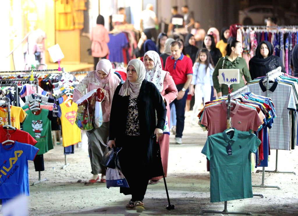 BAGHDAD, Aug. 9, 2019 - Iraqi people shop clothes in preparation for the upcoming Eid al-Adha festival in Baghdad, Iraq, on Aug. 9, 2019.