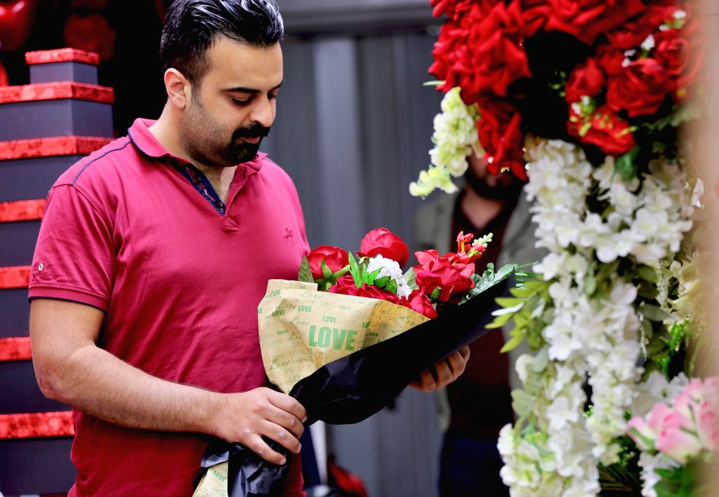 BAGHDAD, Feb. 14, 2019 - A man chooses a gift for Valentine's Day at a gift shop in Baghdad, Iraq, Feb. 13, 2019.