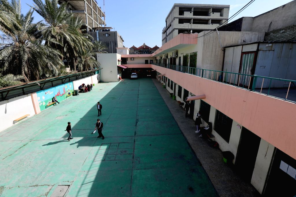 BAGHDAD, Feb. 17, 2019 - Photo taken on Feb. 17, 2019 shows a few students at a primary school in Baghdad, Iraq. Iraqi teachers began on Sunday a two-day nationwide strike, demanding improvement in ...