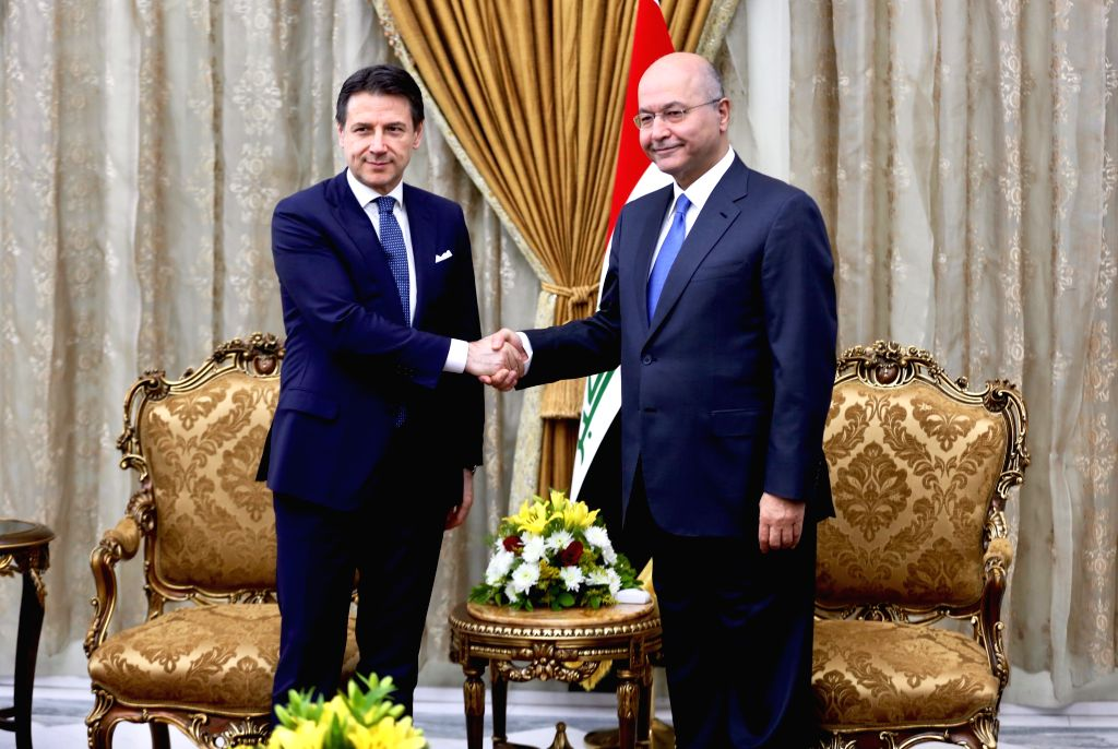 BAGHDAD, Feb. 6, 2019 - Italy's Prime Minister Giuseppe Conte (L) shakes hands with Iraq's President Barham Salih during their meeting in Baghdad, Iraq, on Feb. 6, 2019. Iraq's President Barham Salih ... - Giuseppe Conte