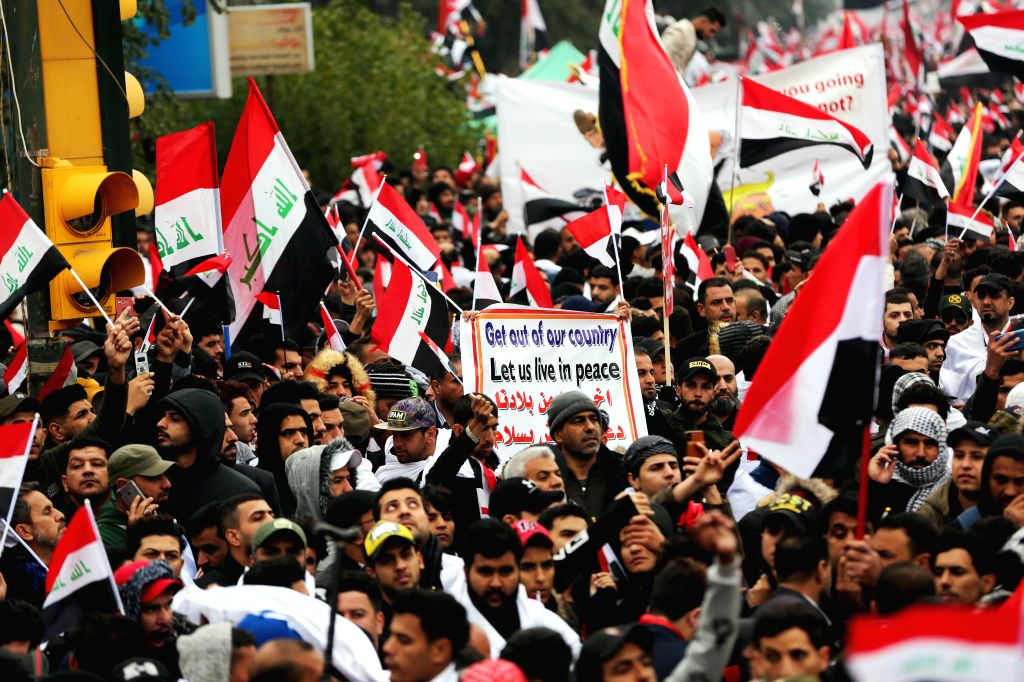 BAGHDAD, Jan. 24, 2020 (Xinhua) -- Iraqi protesters take part in a demonstration against the presence of U.S. troops in the country, in Baghdad, capital of Iraq, Jan. 24, 2020. Iraqi Shia leader Moqtada al-Sadr on Friday called for a scheduled withdr