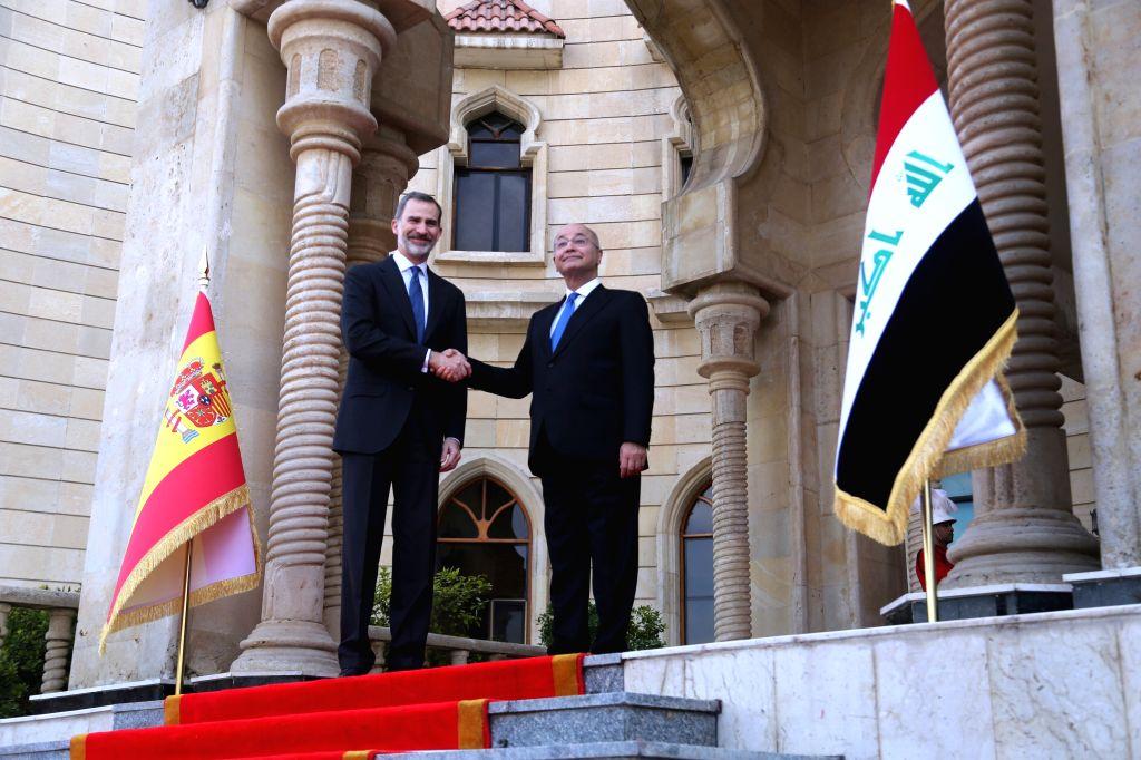 BAGHDAD, Jan. 30, 2019 - Iraqi President Barham Salih shakes hands with visiting Spanish King Felipe VI in Baghdad, capital of Iraq, Jan. 30, 2019.