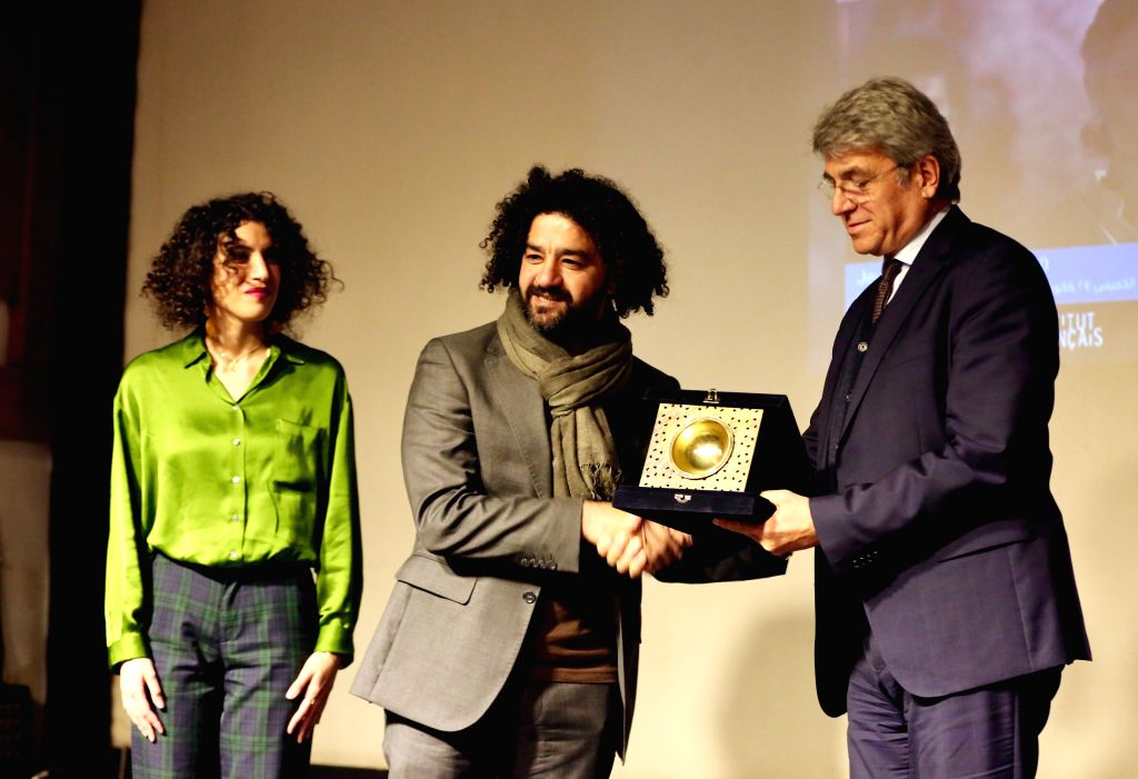 BAGHDAD, Jan. 31, 2019 - Mohammed al-Daradji (C), a filmmaker and the director of the Iraqi Independent Film Center, receives from French Ambassador to Iraq Bruno Aubert the Grand Prize from the ...