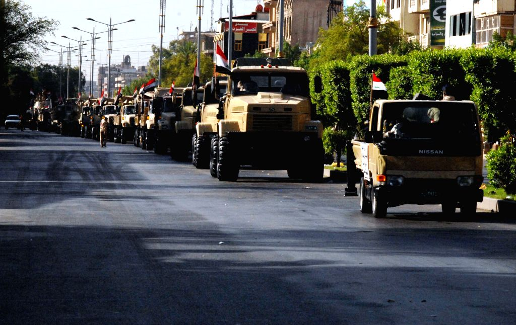 BAGHDAD, July 14, 2016 - Iraqi military vehicles are seen in a military parade in Baghdad, Iraq, July 14, 2016. Prime Minister Haider al-Abadi on Thursday presided over a parade in central Baghdad as ... - Haider