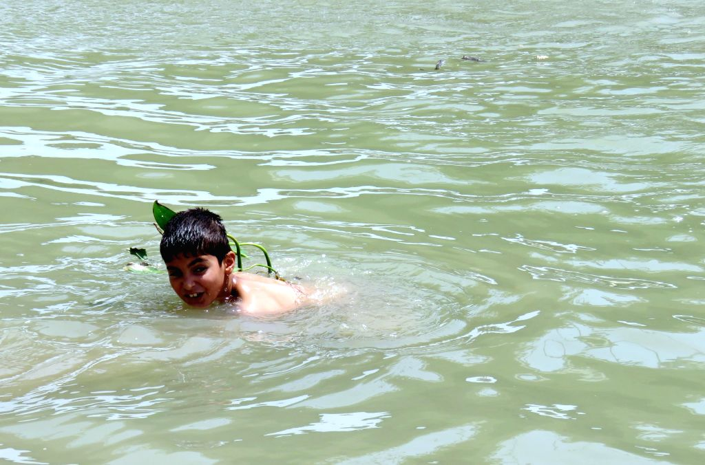 BAGHDAD, July 20, 2016 - A boy swims in the Tigris river to cool down while temperature reaches above 50 degrees Celsius in Baghdad, Iraq, July 20, 2016. The Iraqi government on Tuesday declared a ...