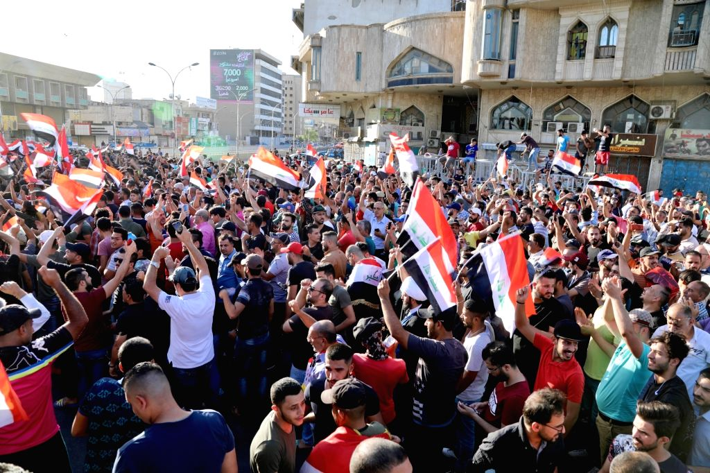 BAGHDAD, July 20, 2018 - Protesters take part in a rally in Baghdad, Iraq, on July 20, 2018. Hundreds of angry protesters took to the streets in Baghdad and southern Iraqi provinces on Friday ...