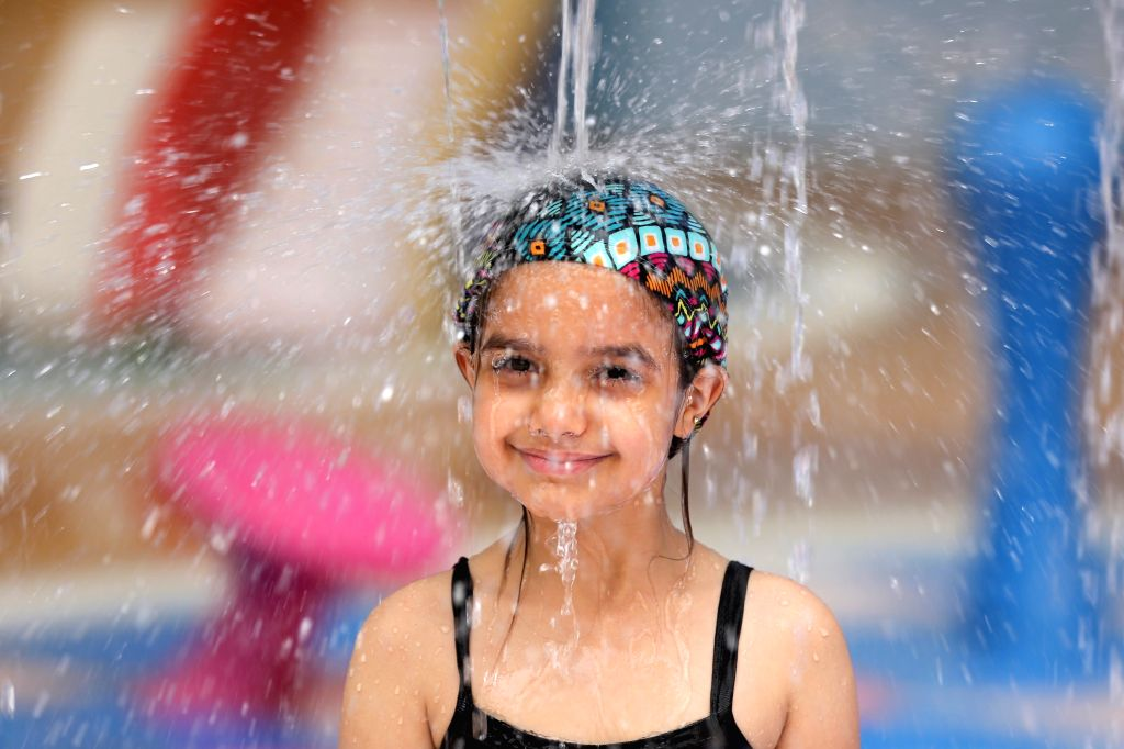 BAGHDAD, July 25, 2019 - A girl cools off at a water park in Baghdad, Iraq, on July 25, 2019. A new heatwave has engulfed Iraq with temperatures jumping to around 50 degrees Celsius in the southern ...