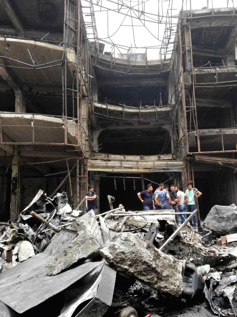 BAGHDAD, July 3, 2016 - Photo taken on July 3, 2016 shows the car bomb attack site in Karrada-Dakhil district of southern Baghdad, Iraq. Death toll of the suicide car bomb attack at a crowded ...