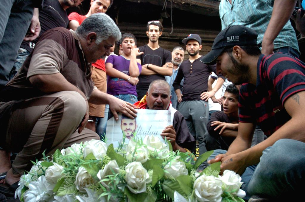 BAGHDAD, July 5, 2016 - A man cries over his son killed in Sunday's car bombing attacks in Karrada-Dakhil district in southern Baghdad, Iraq, on July 5, 2016. Iraq began on Monday a three-day ...