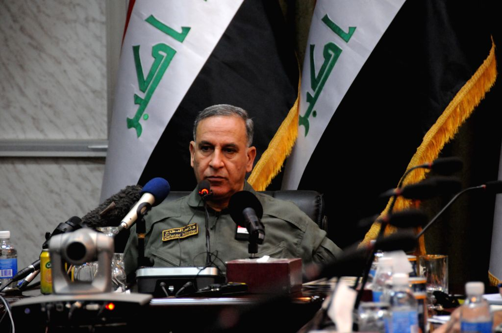Iraqi Defense Minister Khaled al-Obeidi speaks at a press conference in Baghdad, Iraq, March 18, 2015. Iraqi Defense Minister on Wednesday said that the country's ... - Khaled