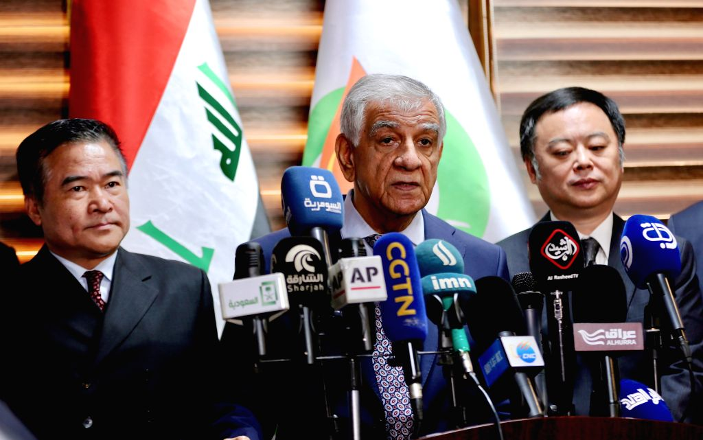 BAGHDAD, May 23, 2018 - Iraqi Minister of Oil Jabbar Luaiby (C) speaks during a press conference after the contract signing ceremony in Baghdad, Iraq, May 23, 2018. The Iraqi Oil Ministry on ...