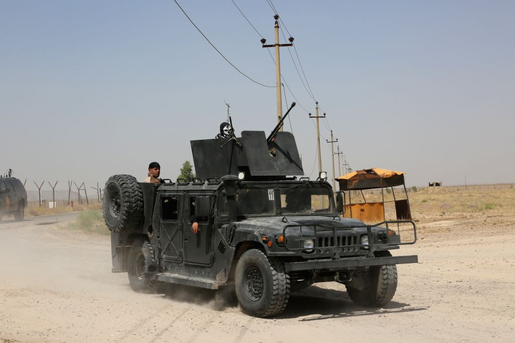 BAGHDAD, May 25, 2016 - Soldiers drive an armored vehicle to the frontline on the outskirts of Fallujah in Iraq's western Anbar province, on May 25, 2016. Iraqi security forces on Wednesday extended ...