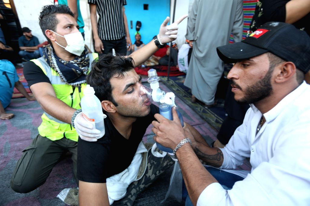 BAGHDAD, Nov. 15, 2019 - A man is treated during a protest in Baghdad, Iraq, on Nov. 15, 2019. Thousands of Iraqis continued Friday anti-government demonstrations in central and southern Iraq over ...