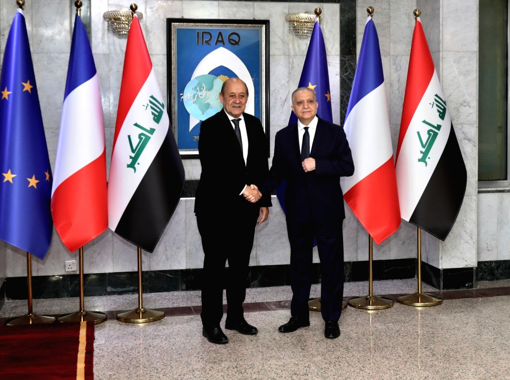 BAGHDAD, Oct. 17, 2019 - Iraqi Foreign Minister Mohammed al-Hakim (R) shakes hands with his French counterpart Jean Yves Le Drian in Baghdad, Iraq, on Oct. 17, 2019. Iraqi Foreign Minister Mohammed ... - Mohammed