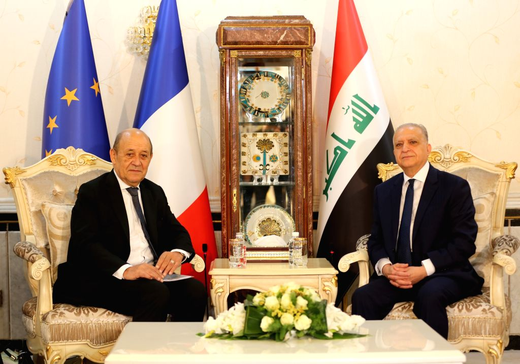 BAGHDAD, Oct. 17, 2019 - Iraqi Foreign Minister Mohammed al-Hakim (R) meets with his French counterpart Jean Yves Le Drian in Baghdad, Iraq, on Oct. 17, 2019. Iraqi Foreign Minister Mohammed al-Hakim ... - Mohammed