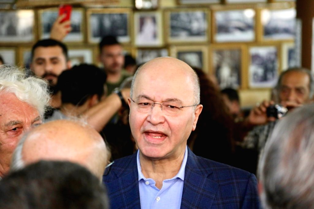 BAGHDAD, Oct. 19, 2018 (Xinhua) -- Iraqi President Barham Salih (C) speaks during his visit to Mutanabi Street, a gathering place for intellectuals and artists in Baghdad, Iraq, on Oct. 19, 2018. Iraqi President Barham Salih on Friday confirmed that