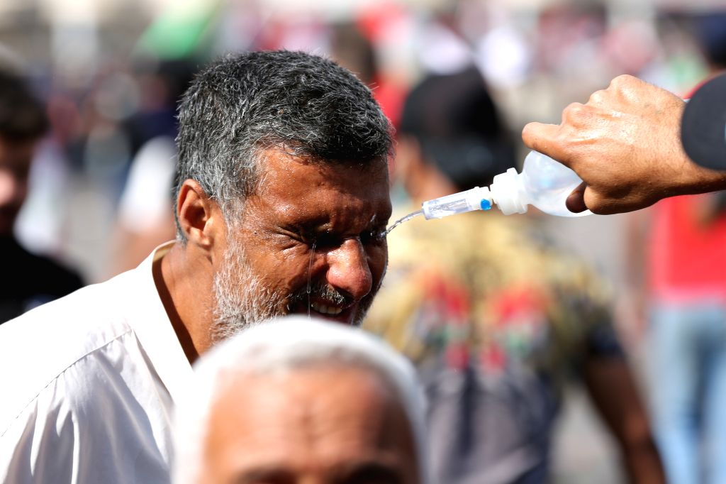 BAGHDAD, Oct. 25, 2019 - A protester gets treatment for tear gas injury during a protest in Baghdad, Iraq, on Oct. 25, 2019. Hundreds of protesters rallied Friday in some Iraqi cities including ...