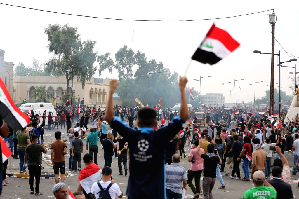 BAGHDAD, Oct. 25, 2019 - Protesters demonstrate in Baghdad, Iraq, on Oct. 25, 2019. Hundreds of protesters rallied Friday in some Iraqi cities including capital Baghdad, amid the resumed ...