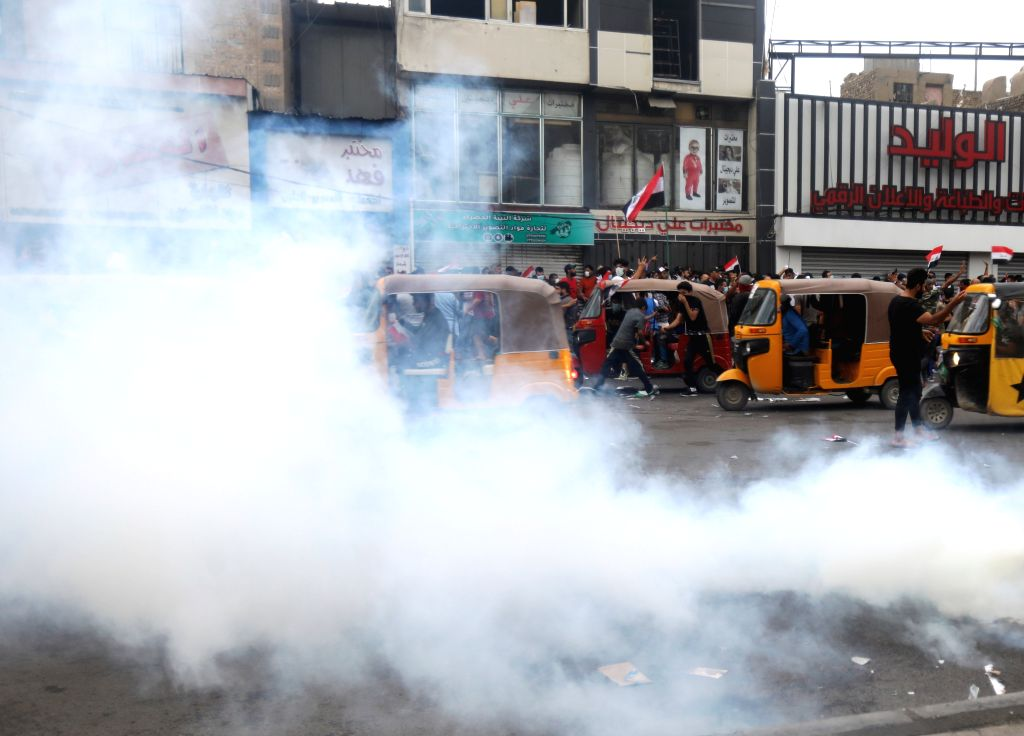 BAGHDAD, Oct. 25, 2019 - Tuk-tuk drivers rush to rescue and transfer wounded protesters to hospitals in Baghdad, Iraq, on Oct. 25, 2019. Hundreds of protesters rallied Friday in some Iraqi cities ...