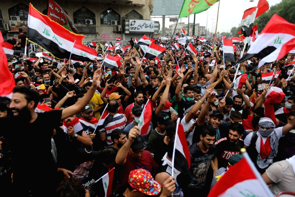 BAGHDAD, Oct. 25, 2019 (Xinhua) -- Protesters demonstrate at the Tahrir Square in Baghdad, Iraq, on Oct. 25, 2019. Hundreds of protesters rallied Friday in some Iraqi cities including capital Baghdad, amid the resumed anti-government demonstrations o