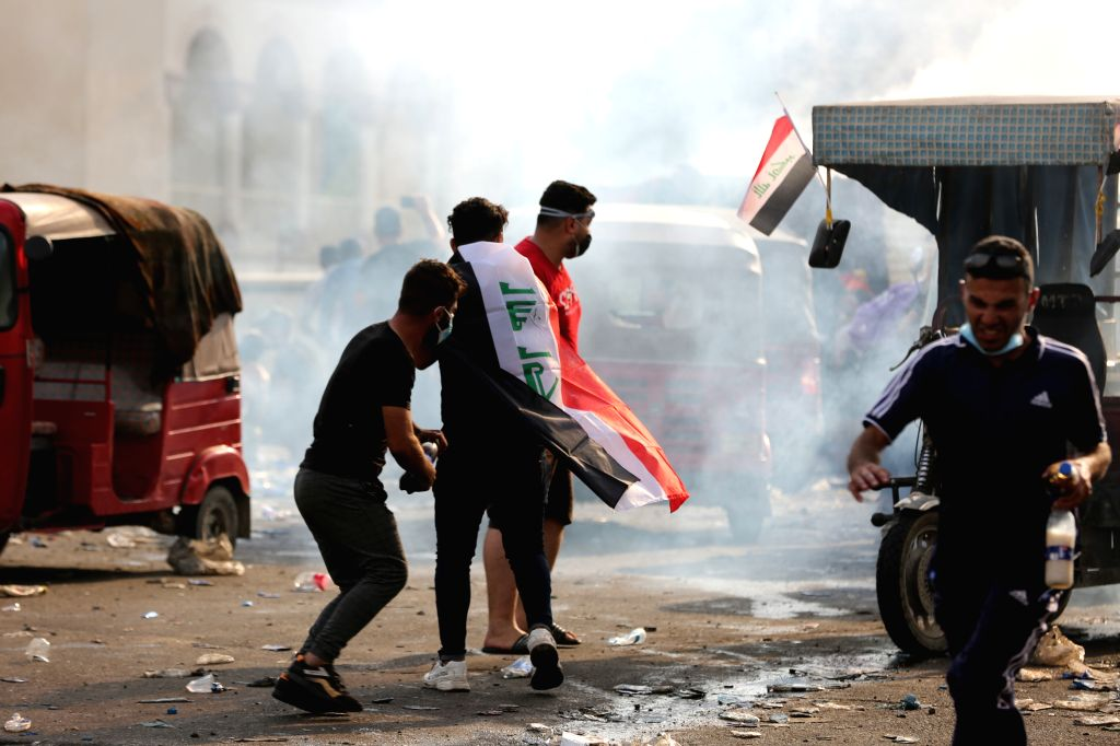BAGHDAD, Oct. 27, 2019 - Protesters are seen at Tahrir square in Baghdad, Iraq, on Oct. 27, 2019. The Iraqi authorities said on Sunday that the death toll from the new wave of nationwide protests ...