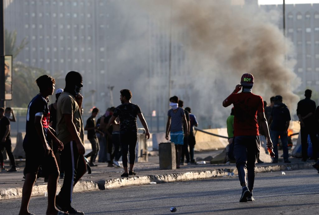 BAGHDAD, Oct. 5, 2019 (Xinhua) -- Protesters burn tires during protests in Baghdad, Iraq, on Oct. 5, 2019. Death toll in five days of violent protests in Iraqi capital Baghdad and other Iraqi provinces climbed to 99 with nearly 4,000 people wounded,
