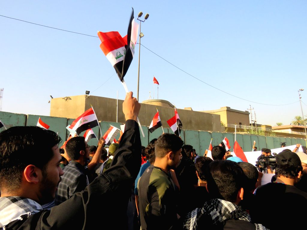 BAGHDAD, Oct. 8, 2016 - Iraqi citizens demonstrate in front of the Turkish Embassy in Iraq against Turkey interfering in Iraq's internal affairs, in Baghdad, Iraq, on Oct. 8, 2016. Turkey on Friday ...