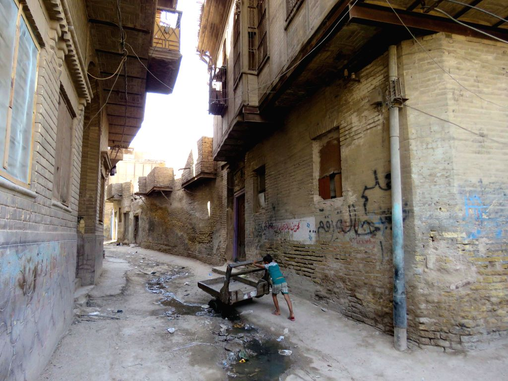BAGHDAD, Sept. 15, 2016 - Photo taken on Sept. 15 shows an Iraqi boy pushing a cart in Baghdad's Al-Rasheed neighbourhood, the oldest area in the Iraqi capital.