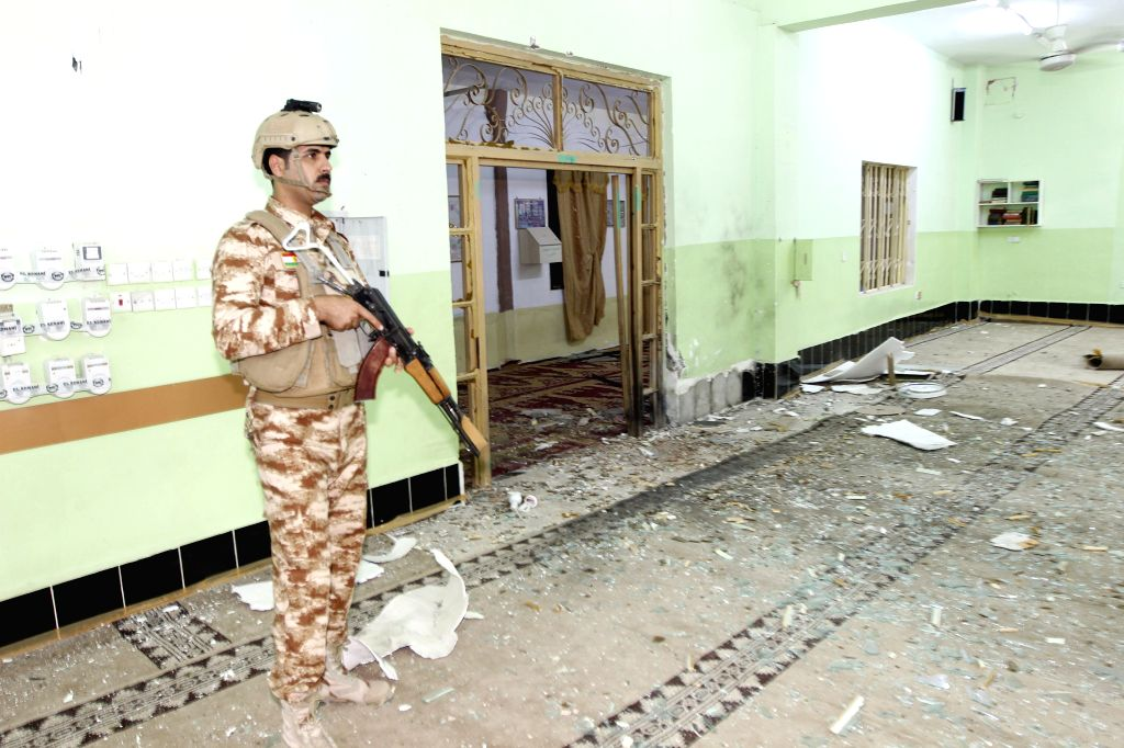 BAGHDAD, Sept. 18, 2016 - A security member stands inside a mosque after a bomb explosion in Kirkuk, northern Iraq, on Sept. 17, 2016. At least one person was killed and four others wounded during ...