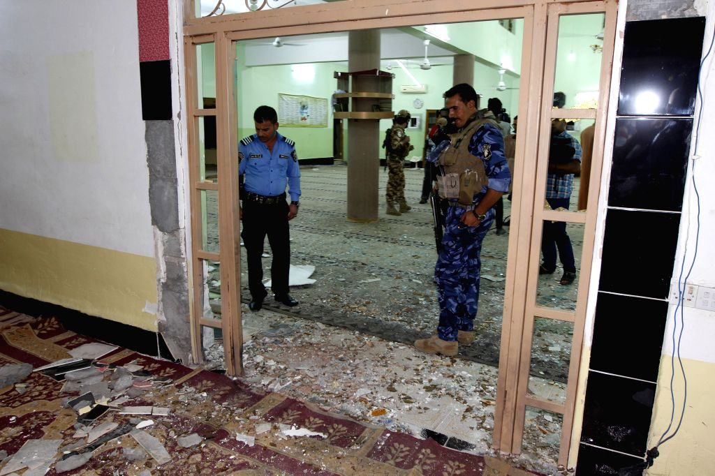 BAGHDAD, Sept. 18, 2016 - Security members guard inside a mosque after a bomb explosion in Kirkuk, northern Iraq, on Sept. 17, 2016. At least one person was killed and four others wounded during the ...