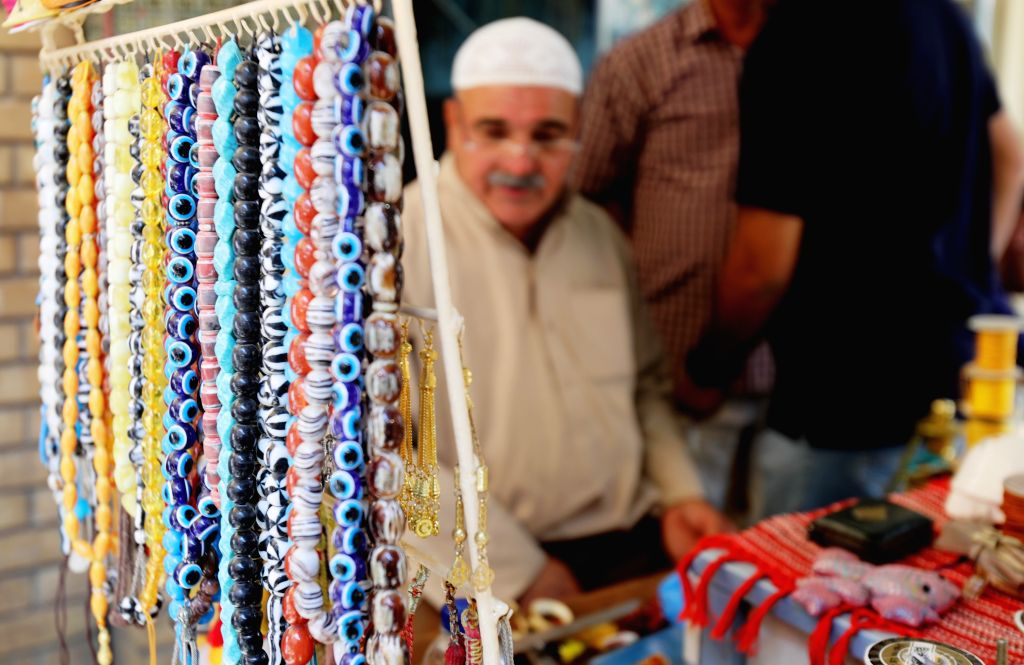 BAGHDAD, Sept. 20, 2019 - A man sells rosaries at his shop at a market in Baghdad, Iraq, on Sept. 13, 2019. The rosaries market in downtown Baghdad is renowned for offering rare gemstones and ...